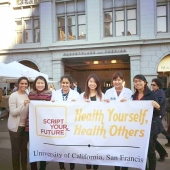 UCSF students holding a Script Your Future banner