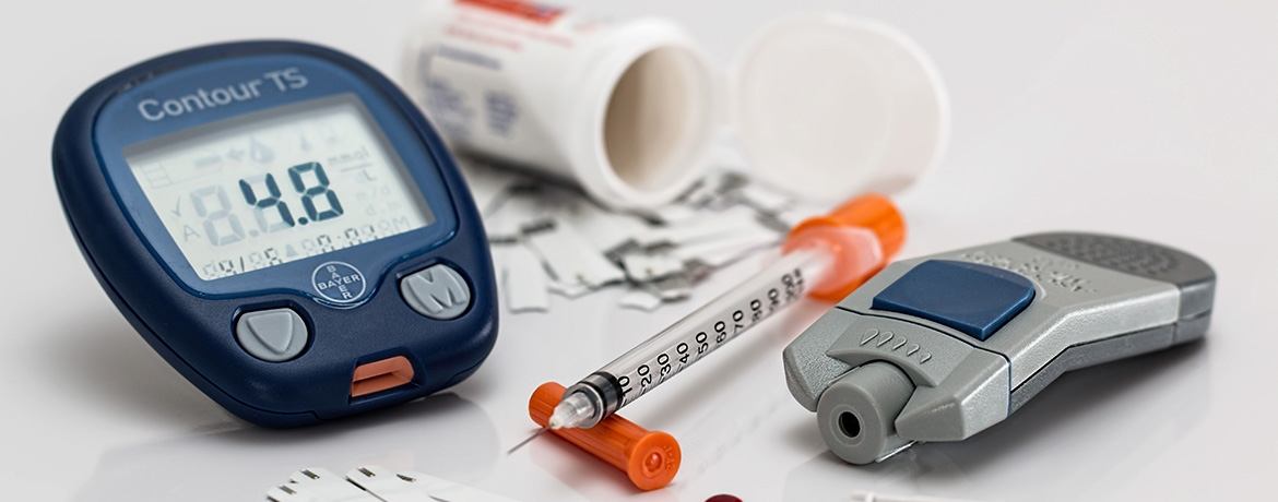 Image of a handheld glucometer, continuous glucose monitor, and insulin pump.