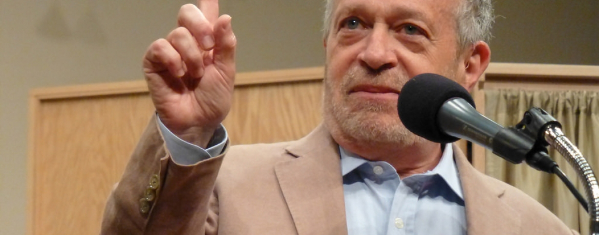 Image of Dr. Robert Reich at a podium.
